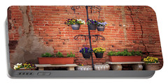 Portable Battery Charger featuring the photograph Potted Plants And A Brick Wall by James Eddy