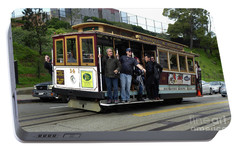 Portable Battery Charger featuring the photograph Powell And Market Street Trolley by Steven Spak