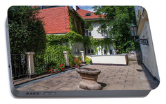 Portable Battery Charger featuring the photograph Prague Courtyards by Jenny Rainbow