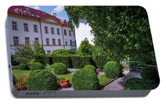 Portable Battery Charger featuring the photograph Prague Courtyards. Regular Style Garden by Jenny Rainbow