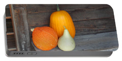 Pumpkin On A Bench Portable Battery Charger by Catherine Gagne