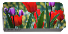 Purple And Red Tulips Portable Battery Charger by Mitch Shindelbower