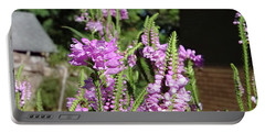 Portable Battery Charger featuring the photograph Purple Bliss by Nick Kirby