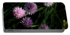 Purple Chives Portable Battery Charger by Angela Rath