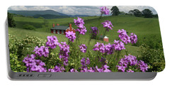 Purple Flower In Landscape Portable Battery Charger