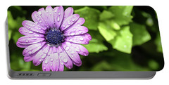 Purple Flower On Green Portable Battery Charger