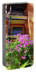 Portable Battery Charger featuring the photograph Purple Flowers By The Balcony by Francesca Mackenney