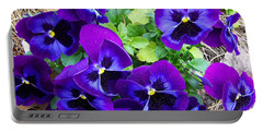 Portable Battery Charger featuring the photograph Purple Pansies by Sandi OReilly