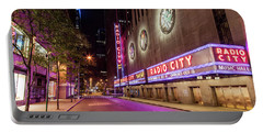 Radio City Music Hall At Night Portable Battery Charger by John McGraw