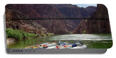 Rafts With Black Bridge In The Distance Portable Battery Charger