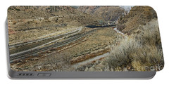 Portable Battery Charger featuring the photograph Railroad Tracks Lead To Power Plant by Sue Smith