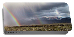 Portable Battery Charger featuring the painting Rain In The Desert by Dennis Ciscel