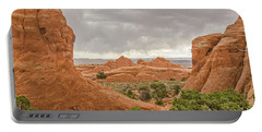 Portable Battery Charger featuring the photograph Rain In The Distance At Arches by Sue Smith