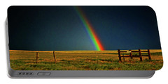 Portable Battery Charger featuring the photograph Rainbow In A Field 001 by George Bostian