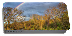 Portable Battery Charger featuring the photograph Rainbow Over The River by Debra and Dave Vanderlaan