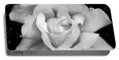 Portable Battery Charger featuring the photograph Raindrops On Rose Black And White by Jennie Marie Schell