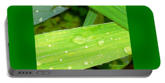 Portable Battery Charger featuring the photograph Raindrops by Elly Potamianos