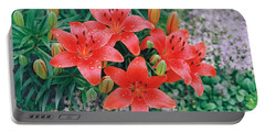 Portable Battery Charger featuring the photograph Raindrops On Crimson Pixie Asiatic Lily by Nancy Lee Moran