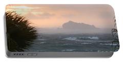 Rainy Xmas Sunrise Portable Battery Charger by Margaret Brooks