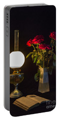 Portable Battery Charger featuring the photograph Reading By Oil Lamp by Brian Roscorla
