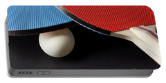 Red And Blue Ping Pong Paddles - Closeup On Black Portable Battery Charger