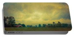 Red Barn Under Stormy Skies Portable Battery Charger by Don Schwartz