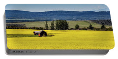 Red Barns In A Sea Of Canola Portable Battery Charger