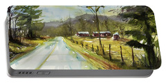 Red Barns On The Right Portable Battery Charger by Judith Levins