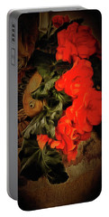 Portable Battery Charger featuring the photograph Red Begonias by Thom Zehrfeld