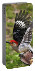 Portable Battery Charger featuring the photograph Red Bellied Woodpecker Take Off by Terry DeLuco