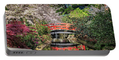 Red Bridge Spring Reflection Portable Battery Charger by James Eddy