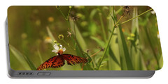 Red Butterfly In Daisy Field Portable Battery Charger
