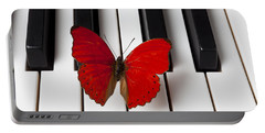 Red Butterfly On Piano Keys Portable Battery Charger