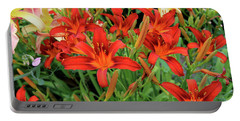 Red Daylilies Portable Battery Charger