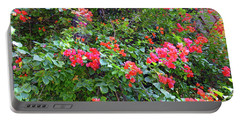 Portable Battery Charger featuring the photograph Red Flower Hedge by Francesca Mackenney