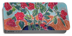 Red Flowers In Black Pot Portable Battery Charger