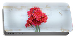 Red Gerbera On White Rustic Wooden Background Portable Battery Charger