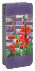 Portable Battery Charger featuring the pyrography Red Gladiolas by Elly Potamianos