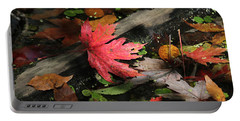 Portable Battery Charger featuring the photograph Red Maple Leaf In Pond by Doris Potter