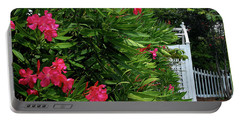 Portable Battery Charger featuring the photograph Red Oleander Arbor by Marie Hicks