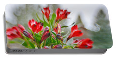 Portable Battery Charger featuring the photograph Red Peruvian Lilies by Diane Alexander