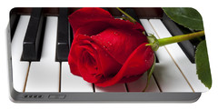Red Rose On Piano Keys Portable Battery Charger by Garry Gay
