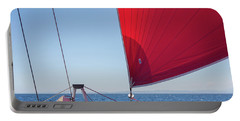 Portable Battery Charger featuring the photograph Red Sail On A Catamaran by Clare Bambers