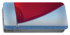 Portable Battery Charger featuring the photograph Red Sail On A Catamaran 2 by Clare Bambers
