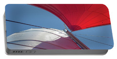Portable Battery Charger featuring the photograph Red Sail On A Catamaran 3 by Clare Bambers