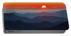 Red Sun In The End Of Mountain Range Portable Battery Charger