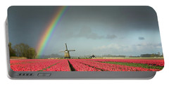 Portable Battery Charger featuring the photograph Red Tulips, A Windmill And A Rainbow by IPics Photography
