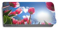 Red Tulips Against Blue Sky Portable Battery Charger