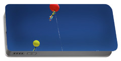 Portable Battery Charger featuring the photograph Red,yellow Balloon Blowing By The Wind In The Air With The Blue  by Jingjits Photography