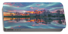 Reflection At Sunrise Portable Battery Charger by Marc Crumpler